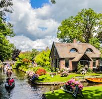 ★228跟團省★【賺很大】荷蘭雙遊船、荷風三色村、古堡花園、庫勒慕勒、Outlet7日